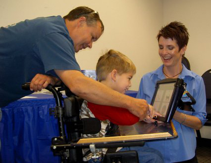 picture of Easter Seals client using AT Lab